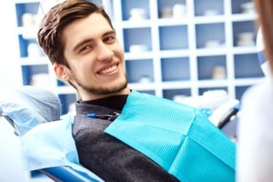 Smiling man in dental chair having a general dental checkup